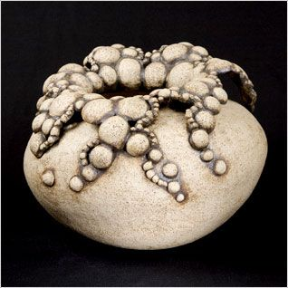 Hilary Simms.  Like the way the glaze is collected  around the bubbles    All the sculpture was made by coiling and pinching the body and assembling the bubbling  parts individually.