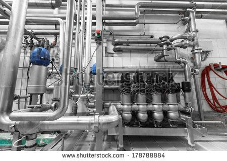 a beer production facility is a modern metal equipment - stock photo