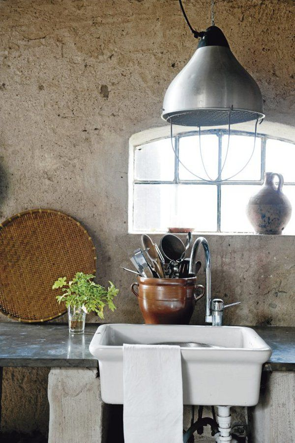 Love the urn used as a utensil holder and the straw basket leaning on the wall.