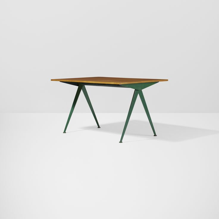Lot 254: Jean  Prouvé. Compas table. 1953, enameled steel, oak. 50¼ w x 33 d x 27¾ h in. result: $20,000. estimate: $5,000–7,000. Provenance: Russell Steele, East Hampton, NY | Collection of Dimitri Levas