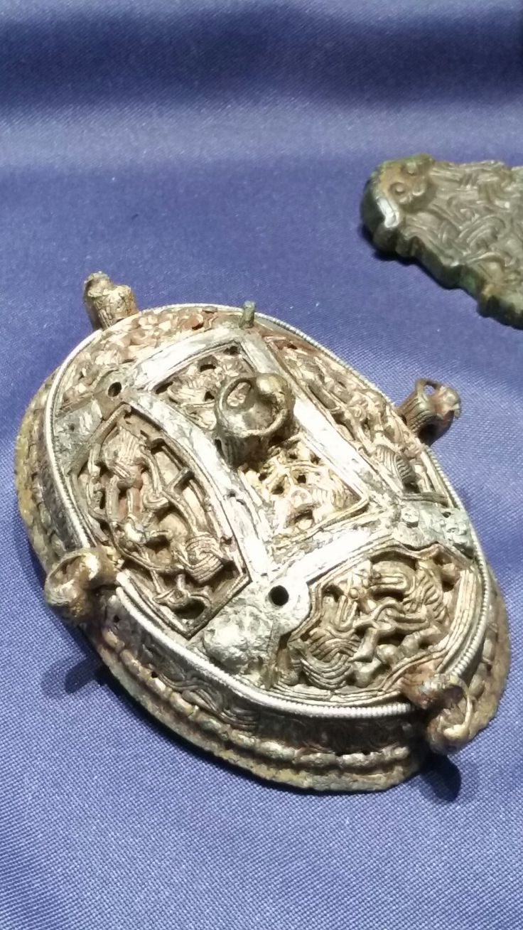 Oval brooch, double shelled. Gilt bronze with silver details. 9th century. Jaren, Hurum in Buskerud, Norway. On exhibit at Kulturhistorisk museum in Oslo.