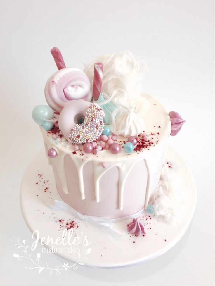 Pink drip cake with fondant donut. By Jenelle's Custom Cakes!
