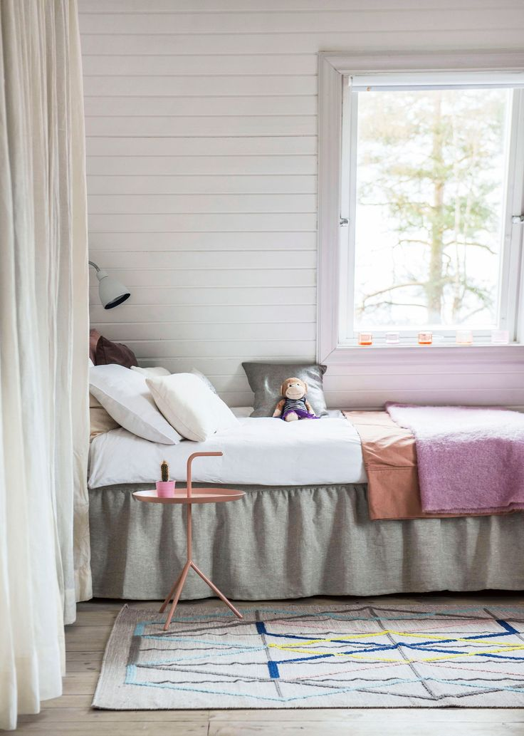 Pretty in pink | pastel bedroom of a young girl | white bedding with pink and coral bedspread | white curtains | natural Bemz Loose Fit Country bedskirt in Unbleached Rosendal linen | pink Hay bedside table