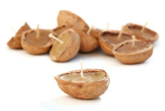 I'd love to try to make these... 8 Walnut Shell Floating Candles - Beeswax. $10.00, via Etsy.