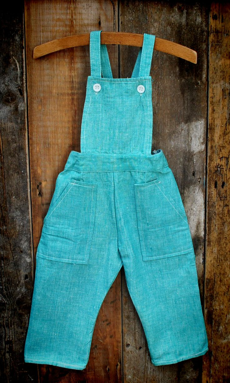 1970S GREEN DENIM DUNGAREES  15.00 1970's Green unisex dungarees age 1-2 years  Unworn green denim dungarees, with elasticated waistband and pocket detail. 'Empire made' by Visor.