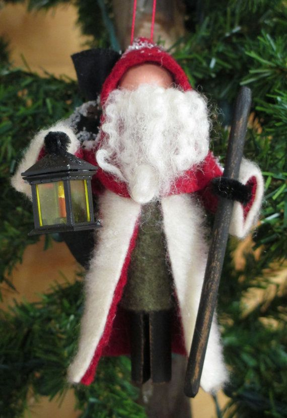 "ModerationCorner-on Etsy Materials: Clothespin, Wood Ball, Paint, Wool Felt, Faux Fur, Sheep Fiber, Homespun, Dowel, Lantern..size-4.5"" W x 5 "" H New in 2014, our Old World Santa has the feel of an old European traveler. He wears an under coat of green with a long red cloak lined in"