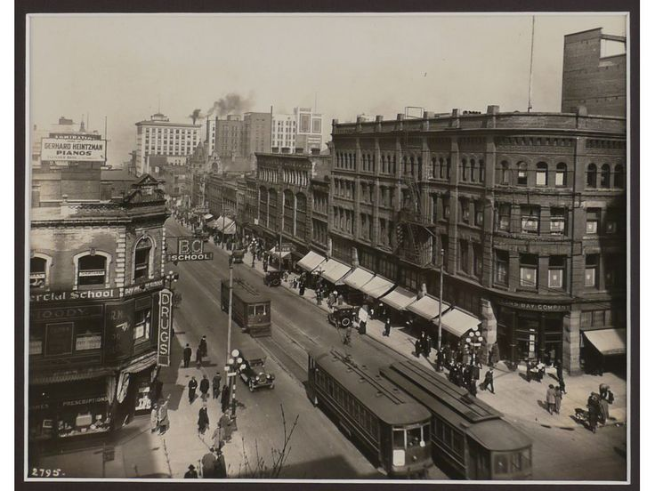 Granville and Georgia in Vancouver, early 1920s. This view looks north up Granville. The old Hudson's Bay building is across the street; it's only four storeys and has a brick facade, which means the photo is before 1926, when the building was expanded to six storeys and given a cream terra cotta facade.
