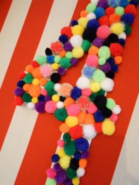 Pom pom backdrop Super cute idea use cardboard draw a two cut out with exacto knife and glue Pom poms on