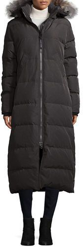 """Canada Goose """"Mystique"""" long parka with natural coyote fur (Canada) trim. Approx. 49""""L down center back. Removable hood; two-way zip front. Long sleeves. Fleece-lined pockets. Calf-length hem. Polyester/cotton. Duck down/feather fill. Dry clean. Made in Canada."""