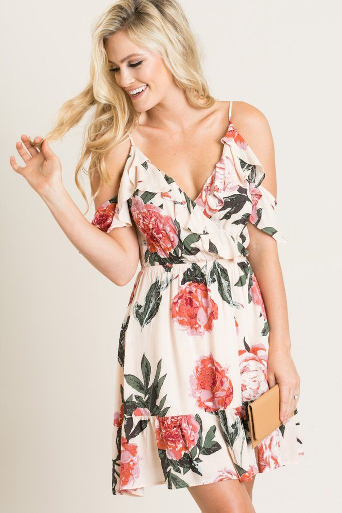 This mini sundress is part of our everyday wardrobe this Summer! This ultra feminine piece is adorned with a ruffled...