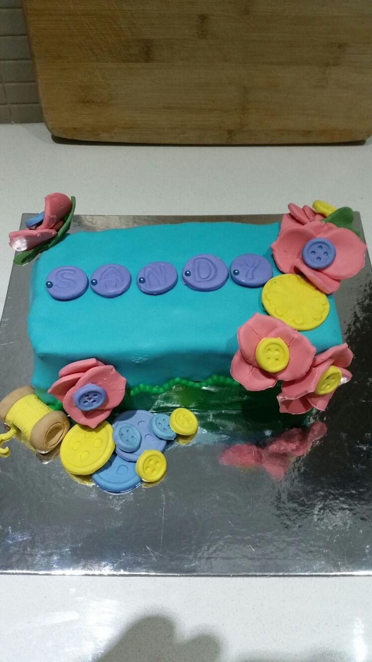 Button flowers,  and thread sewing themed cake.
