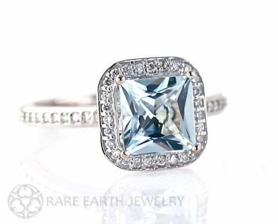 A lovely natural Aquamarine and Diamond ring in your choice of 14K White,  Yellow or