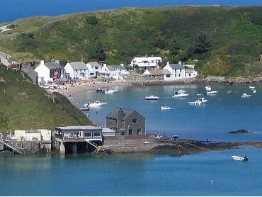"Porth Dinllaen, the village built on the beach :) run at high tide. The pub being the main attraction the ""Ty Coch"" Inn."