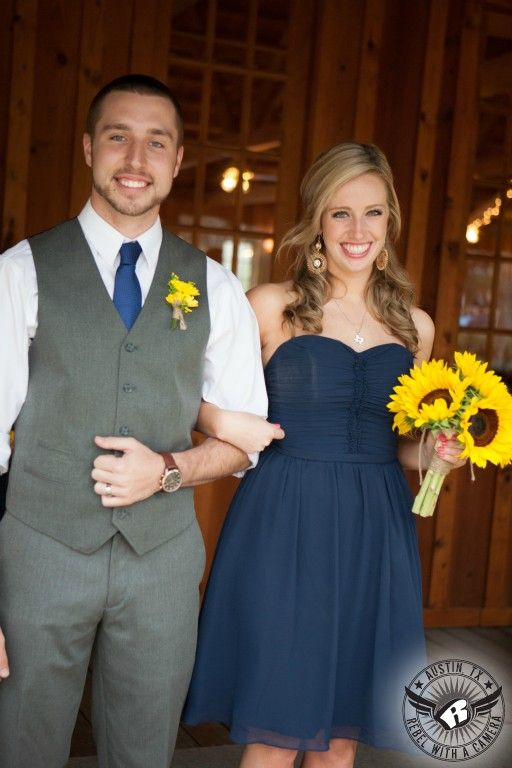 Grey vest for groomsman and navy dress for bridesmaid.