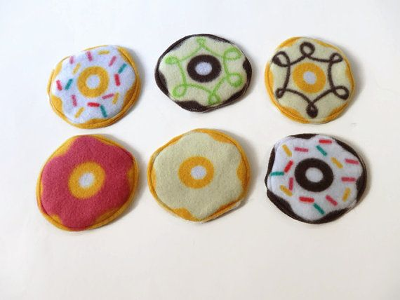 These mini donut pads are great for absorbing liquid from a leaky water bottle! They also add color and cuteness to your cage :) You will receive randomly selected donut patterns. If you would like a specific pattern, please indicate that at checkout. Bakery box is not included. These are about 4 diameter pads that are made with an absorbent layer between two layers of fleece. They will not be perfectly circular. For larger quantities, feel free to message me!  These are washer and dryer…