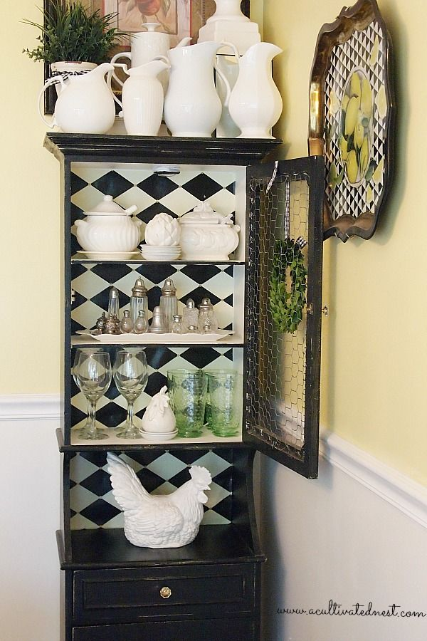 decorating a small china cabinet and a tip about where to get the best selection of paper to line the back of a cabinet