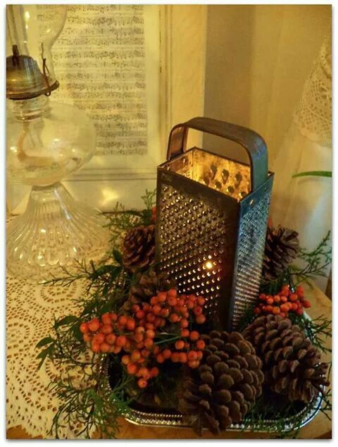 Vintage grater makes a great candle holder for Christmas.