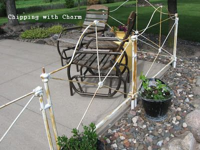 Chipping with Charm: Vintage Headboard Patio Fence
