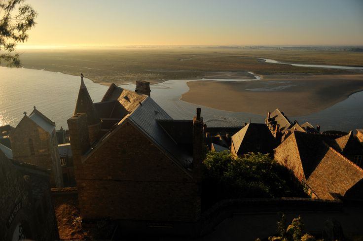 https://flic.kr/p/86E9DU   Mont Saint Michel Village   View this picture large Just after sunrise, as the tide began to rise in Saint Michel Bay, there was some beautiful light on the village surrounding the monastery.