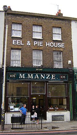 Pie & mash is a traditional London working-class food, originating in London's East End. Pie, mash & eel shops have been in London since the 19th century & are still common in south & east London, & many parts of Kent & Essex. The shops may serve either or both steamed & jellied eels. M. Manze in Peckham have been serving this dish since 1902.