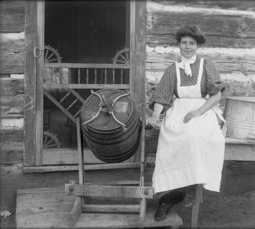 Agriculture - ranching - woman churning butter :: History Colorado 1890. Didn't have time for anything else, just helping to provide for the family...... God bless her!!! Worked sunrise to sunset!! notice the fab doo dads ('gingerbread' designs) in the corners of screen door! Anything to make it pretty and homey!
