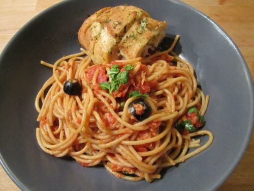 Spaghetti Puttanesca with garlic ciabatta