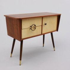 Pretty little lowboy from the early 1960s (?)— two-tone wood, wonderfully leggy.