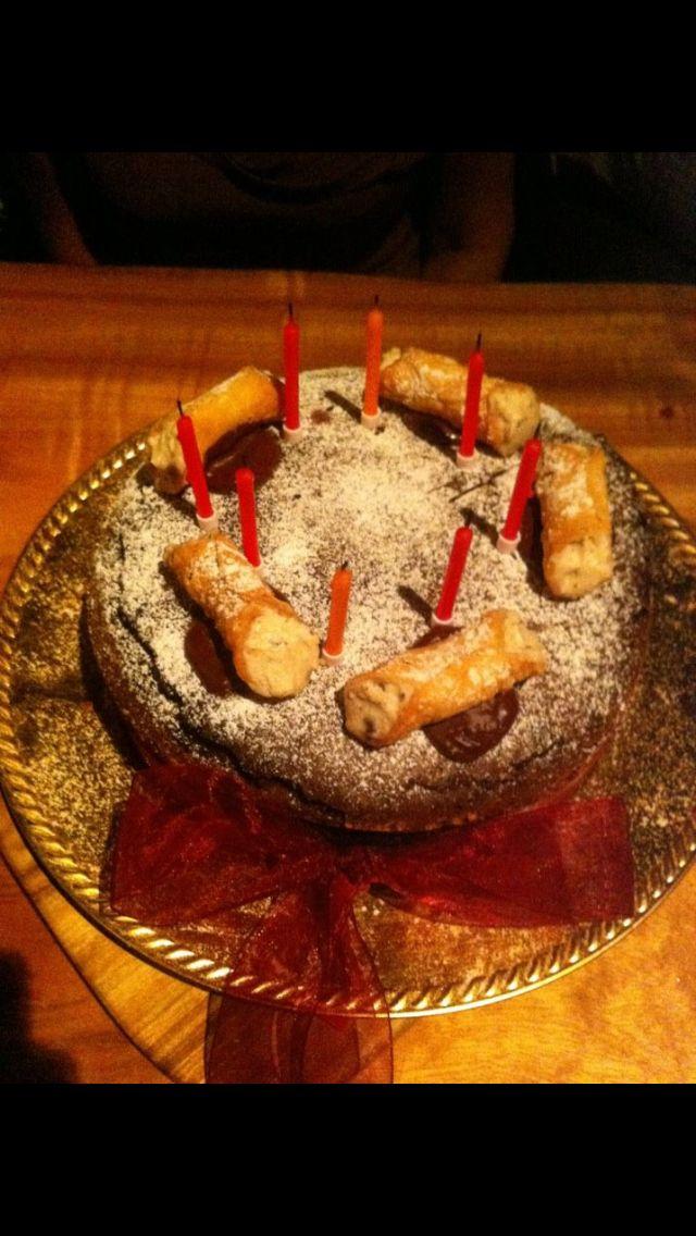 Guinduia Cake topped with Mini Ricotta Cannoli