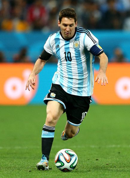 Lionel Messi Photos - Lionel Messi of Argentina controls the ball during the 2014 FIFA World Cup Brazil Semi Final match between the Netherlands and Argentina at Arena de Sao Paulo on July 9, 2014 in Sao Paulo, Brazil. - Netherlands v Argentina