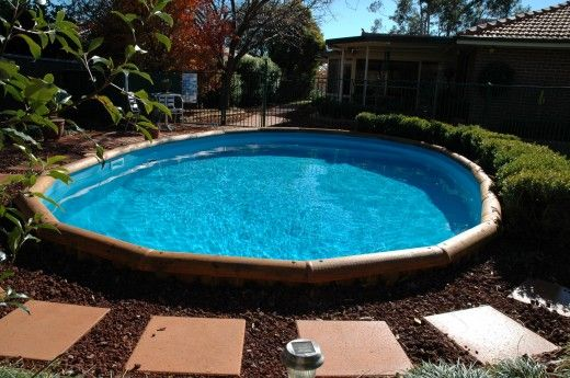 Stunning Semi Inground Pools With Concrete Walkway Unit Combined With Green Landscaping Edging Decoration Ideas