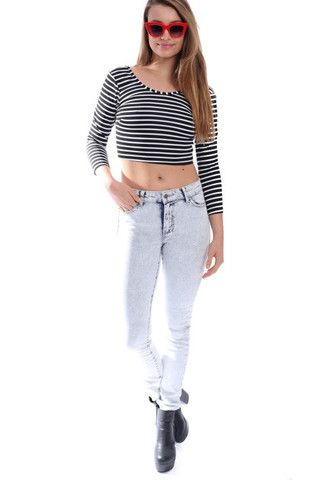 You'll have legs for days in these high waisted acid washed jeans. Shop: http://www.inbetweentangerine.com/products/junk-jeans