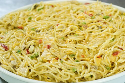 chicken spaghetti.  by Ree Drummond / The Pioneer Woman,   She does from scratch and very detailed.  I cheat. LOL  I buy cooked chicken fajita strips and I use canned broth. Believe it or not, the pimento's are what make it.  Yum.  You can make variations too.  with or without cheese.