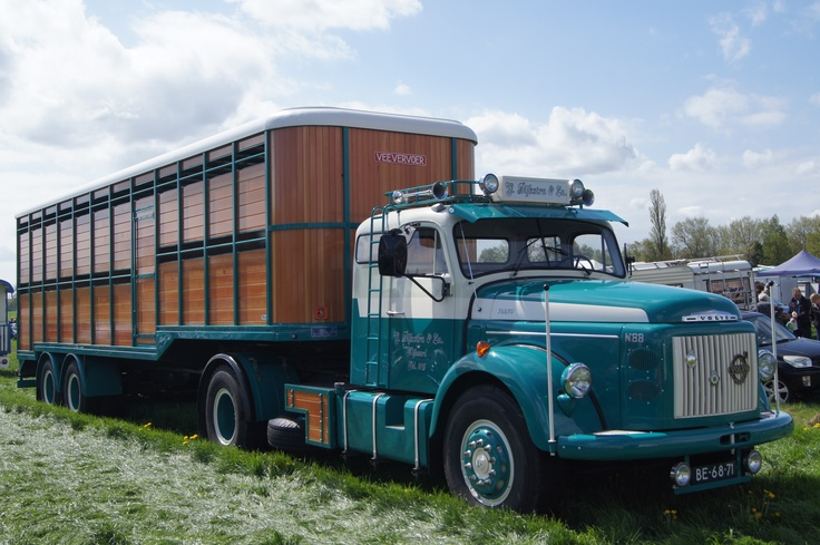 Restored Volvo N88 dating from 1968 pulling a wooden DAF livestock trailer (1961) during a vintage vehicle show in Holland on May 19th 2013.