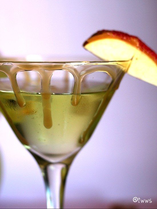 Caramel Apple Martini 1 oz vodka 1 oz Sour Apple Pucker 1/2 oz Butterscotch Schnapps Pour some caramel ice cream topping into a wide mouthed bowl.  Dip the rim of your glass into the caramel.  Set aside, or refrigerate until ready to serve. Mix your ingredients in a cocktail shaker along with some ice and shake vigorously. Using a strainer, pour into martini glass. Garnish with an apple, or a caramel apple wedge.