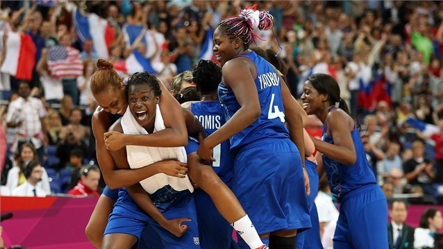 Endene Miyem #5 (L) of France celebrates with Sandrine Gruda #7after defeating Russia 81-64 in the Women's Basketball semifinal on Day 13 of the London 2012 Olympics Games at North Greenwich Arena