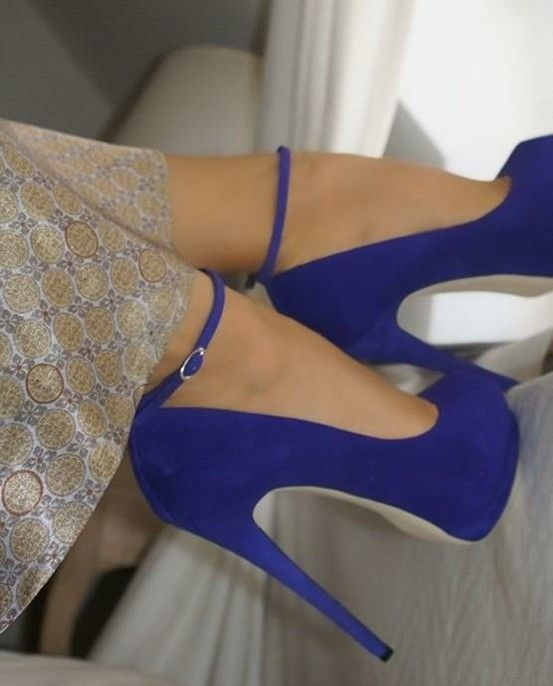 Royal blue suede pumps with white soles and thin ankle strap. I'd pair them  with white jeans, stripes, and maybe a pale blue blazer with a bright  clutch.