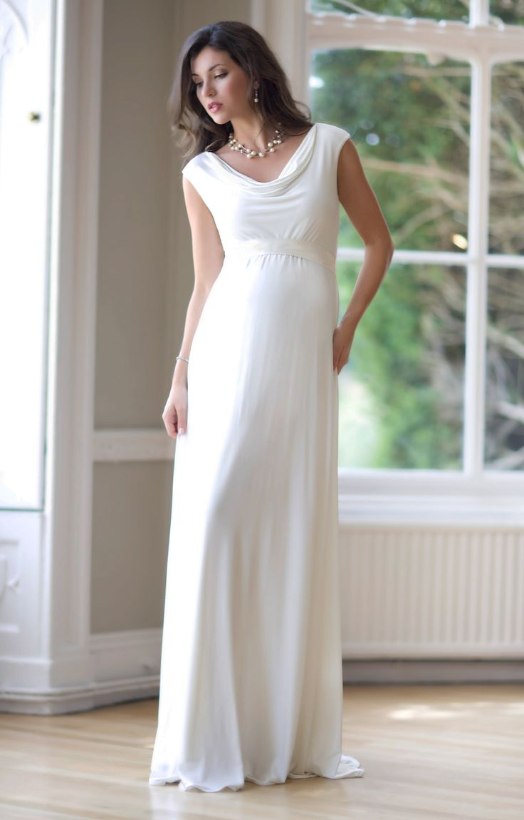 A fresh, relaxed maternity wedding dress with flattering cowl neckline and empire line sash.