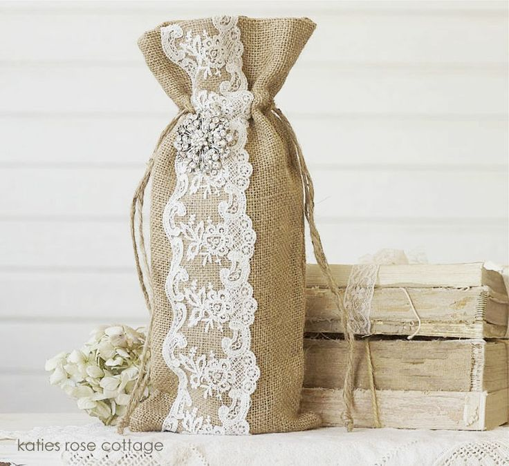 Closeup Shown: Burlap & Lace Wine Bag, $17.50 + Ship   ~  This is a burlap and lace wine bag with a beautiful rhinestone jewel ~ It measures 12.5 inches tall ~  http://www.katiesrosecottagedesigns.com  (03.09.13)