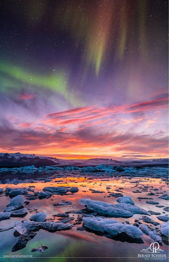 ~~Aurora over Jokusarlon • pastel northern lights light up the glacier bay, Iceland • by Bernd Schiedl~~