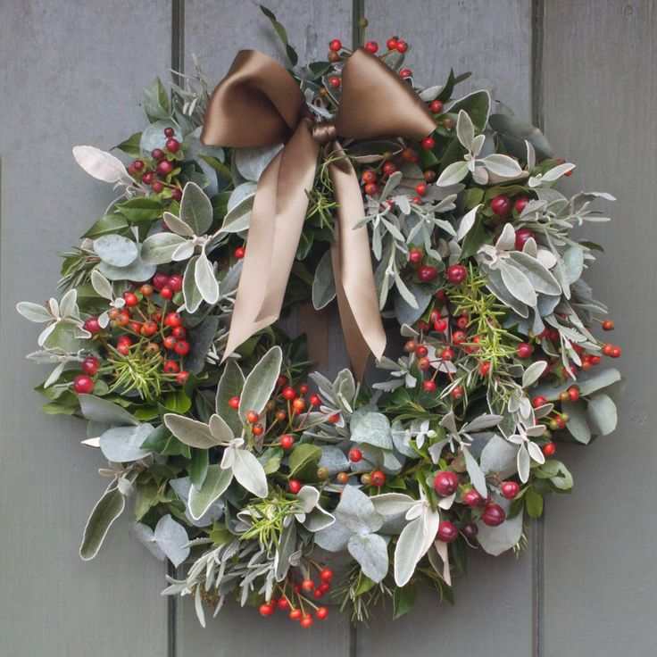 Our beautiful door wreaths are a perfect way to welcome guests to your home this Christmas. This wreath combines Rose Hips and Hypericum Berries with Rosemary, Lavender and Eucalyptus finished with a beautiful green ribbon to tie to your door. This door wreath will measure around 14 to 16 inches diameter.