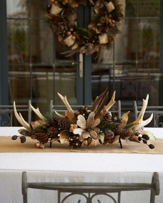 LOVE this one. This natural centerpiece is the perfect way to dress up your table for the holidays!