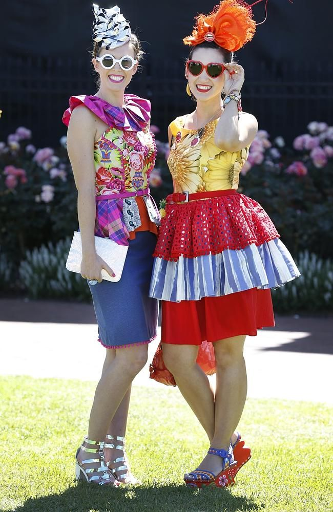 Baylee Knight and Angela Menz wearing Angela Menz designs. Picture: David Caird BOLD, colourful and fun has been the brief for the fashion flock at Flemington for the iconic Melbourne Cup.
