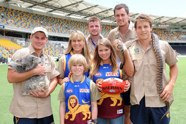 Bindi Irwin and Terri Irwin Photos Photos - Lions players (L-R) Dayne Zorko, Pearce Hanley, Matthew Leuenberger and Zac O'Brien pose for a photo with Terri, Robert and Bindi Irwin during a Brisbane Lions AFL media opportunity at The Gabba on February 3, 2014 in Brisbane, Australia. - Brisbane Lions Media Opportunity