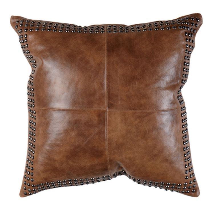 """Evoking the warm, familiar feeling that comes with donning a well-worn pair of boots, this lightly worn 100 percent leather pillow says, """"kick back and relax."""" It features four-panel construction on f"""
