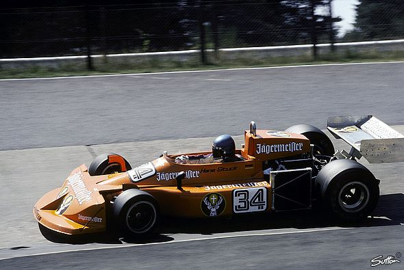 "1976: Hans-Joachim Stuck in a March 761 passing the ""Karussell"" at the German Grand Prix"