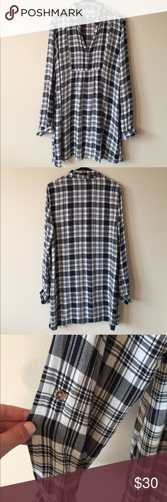 Abercrombie and Fitch Plaid Dress Excellent condition! Soft viscose fabric. Black and White Plaid. Buttons at bust. Length: 34 inches. Armpit to Armpit: 22 inches. Convertible sleeves. Abercrombie & Fitch Dresses