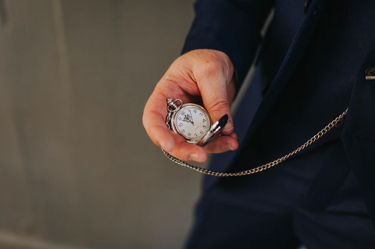 Counting down the hours with his beautiful pocket watch. Photo by Benjamin Stuart Photography #weddingphotography #pocketwatch #groom #weddinggift #weddingday #clock #time