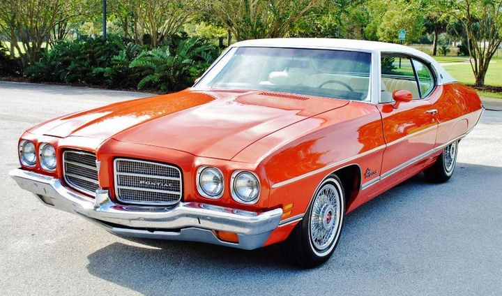 '71 Pontiac LeMans sports coupe. I had one similar in 1972) - same color except vinyl top was black. It was very quick and I absolutely loved the car.