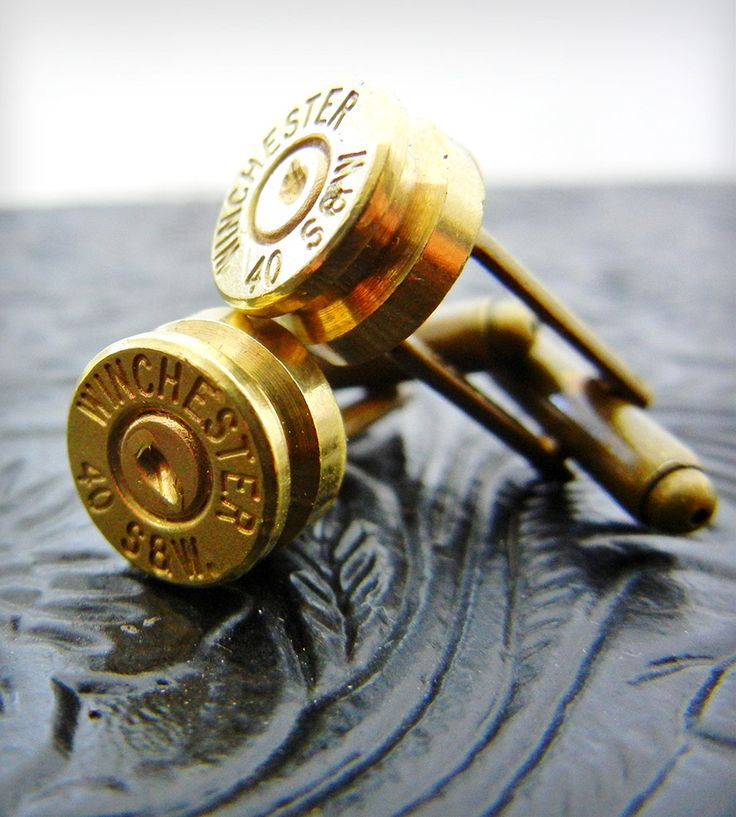 These dashing cufflinks were created using genuine 40 and 45mm Smith & Wesson bullet casings. The brass bases are a swivel cufflink style.