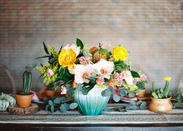 Colorful summer wedding centerpiece with poppies.